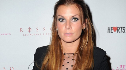 Coleen Rooney smoulders in a sixties style LBD as she looks trimmer