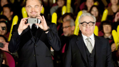 Leonardo DiCaprio Snaps Photos of Fans at Tokyo Premiere of Wolf of Wall Street