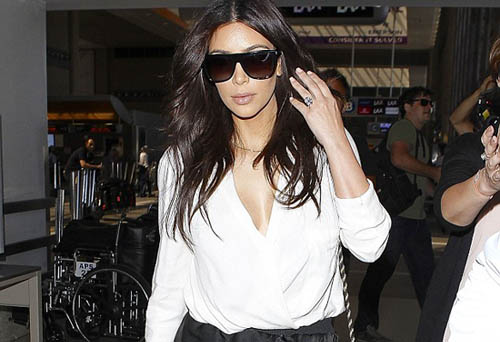 Kim Kardashian arrives at LAX amid rumours She and Kanye are to Wed this week