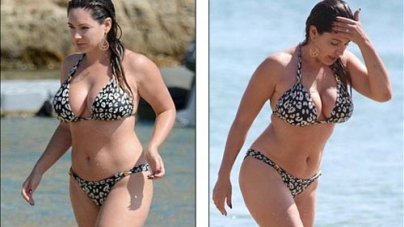 Kelly Brook flaunts her curves as she has fun with fiancé David