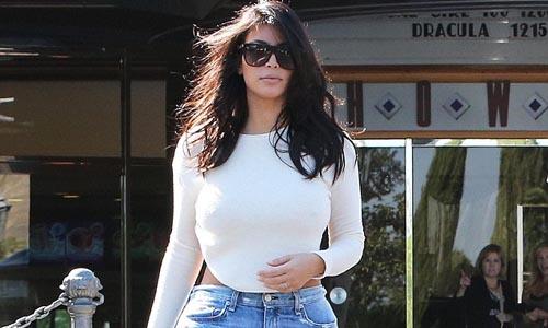 Kim Kardashian in denim Bermuda shorts,  on date with Kanye West