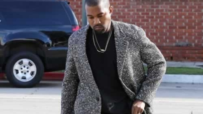Kanye West Sports a Glum look Heading into the Studio