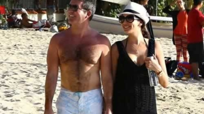 Simon Cowell and Lauren Silverman look loved up