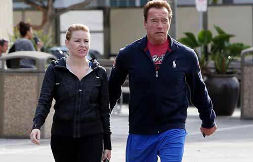 Arnold Schwarzenegger with Heather Milligan