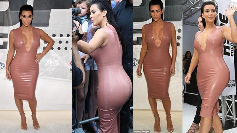 Kim Kardashian Squeezes into Latex Dress With a VERY Plunging Neckline