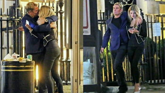Shane Warne seen kissing a mystery blonde in London